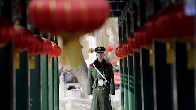 A paramilitary policeman stands guard as the Chinese Lunar New Year which welcomes the Year of the Monkey is celebrated at Daguanyuan park in Beijing