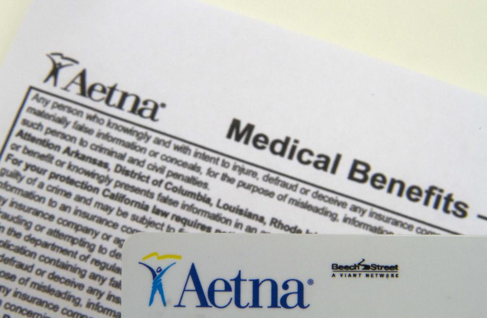 Aetna 4Q profit sinks 49 pct, medical costs climb