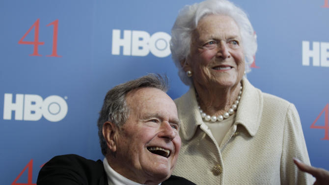 FILE - In a Tuesday, June 12, 2012 file photo, former President George H.W. Bush, and his wife former first lady Barbara Bush, arrive for the premiere of HBO's new documentary on his life near the family compound in Kennebunkport, Maine. A spokesman for the 41st president said Monday, Jan. 7, 2013 that Bush's recovery from a bronchitis-related cough and subsequent complications is continuing  and there's still no timetable for his release from from the hospital. Bush, 88, has been in Methodist Hospital in Houston since Nov. 23. (AP Photo/Charles Krupa, File)