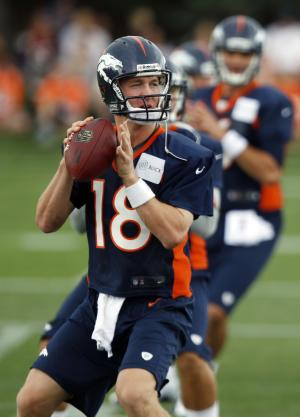 FILE - In this July 27, 2012, file photo, Denver Broncos quarterbacks Peyton Manning, front, Caleb Hanie, center, and Brock Osweiler take part in drills at the team's training camp in Englewood, Colo. Manning continues to make progress in his comeback from a nerve injury in his neck, but some of his receivers are starting to get nicked up at camp, crimping his timing with his new targets.  (AP Photo/David Zalubowski, File)