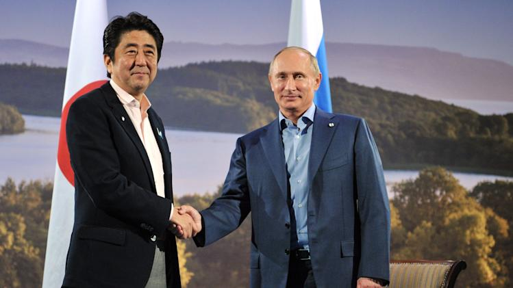 In this photo taken on Monday, June 17, 2013, Japanese Prime Minister Shinzo Abe, left, and Russian President Vladimir Putin pose for a photo prior their talks in Enniskillen, Northern Ireland. (AP Photo/RIA-Novosti, Alexei Nikolsky, Presidential Press Service, Pool)