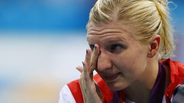 Britain's Rebecca Adlington wipes away tears after receiving her bronze medal on the podium during the women's 800m freestyle victory ceremony at the London 2012 Olympic Games (Reuters)