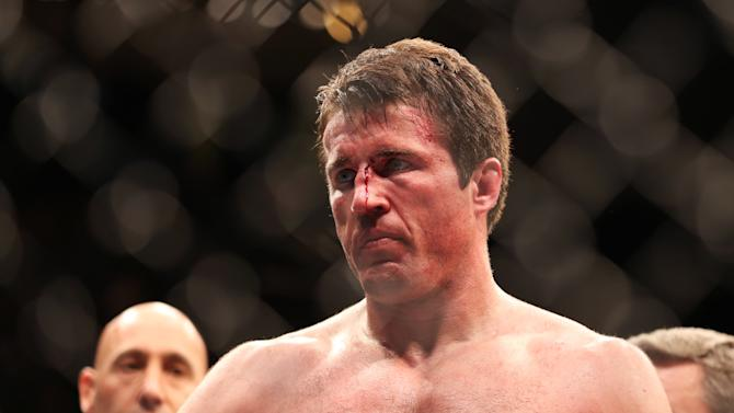 A defeated Chael Sonnen is seen after losing to Champion Jon Jones in their UFC 159 Mixed Martial Arts light heavyweight title bout in Newark, N.J., Saturday, April 27,2013.  Jones retained his title via  first round TKO. (AP Photo/Gregory Payan)