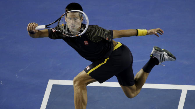 Serbia's Novak Djokovic makes a forehand return to Ryan Harrison of the US during their second round match at the Australian Open tennis championship in Melbourne, Australia, Wednesday, Jan. 16, 2013. (AP Photo/Rob Griffith)