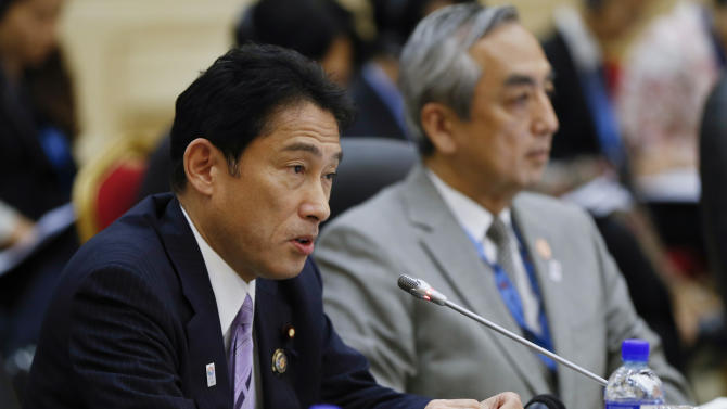 Japan's Foreign Minister Fumio Kishida, left, speaksduring the 46th ASEAN Foreign Ministers' Plus Three Meeting in Bandar Seri Begawan, Brunei, Sunday, June 30, 2013. (AP Photo/Vincent Thian)