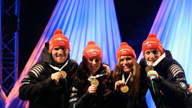 Gold medallists Slesingr, Soukalova, Vitkova and Moravec of the Czech Republic pose for pictures on the podium during the medal ceremony of the Mixed relay competition of the IBU Biathlon World Championships at the Joensuu Square