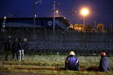 UK response to migrant crisis is inadequate, say senior ex-judges