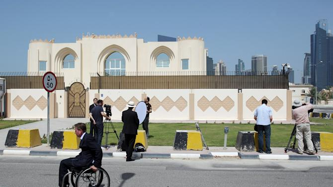 """This photo taken on Thursday, June 20, 2013 shows the new office of the Afghan Taliban in Doha, Qatar after the opening of the office several days ago. The United States on Thursday welcomed Qatar's decision to take down a sign that cast the Taliban's new office in Doha as a rival Afghan embassy saying the militant group can't represent itself """"as an emirate, government or sovereign."""" (AP Photo/Osama Faisal)"""