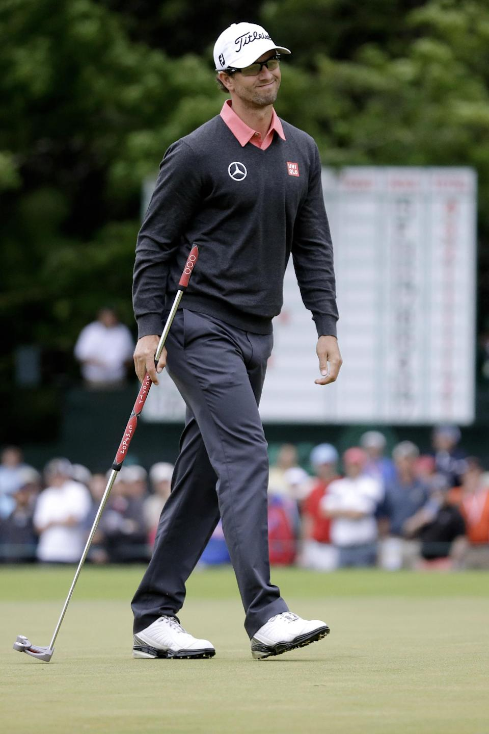 Adam Scott, of Australia, reacts after putting on the 14th hole during the first round of the U.S. Open golf tournament at Merion Golf Club, Friday, June 14, 2013, in Ardmore, Pa. (AP Photo/Morry Gash)