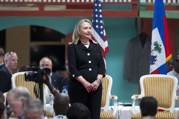Secretary of State Hillary Rodham Clinton delivers a speech during the inauguration ceremony of the Caracol Haiti Industrial Park on the outskirts of Cap Hatien, Haiti, Monday, Oct. 22, 2012. Clinton encouraged foreigners to invest in Haiti as she and her husband Bill led a star-studded delegation gathered Monday to inaugurate the new industrial park at the center of U.S. efforts to help the country rebuild after the 2010 earthquake. At left, Haiti's Prime Minister Laurent Lamothe. (AP Photo/Dieu Nalio Chery)