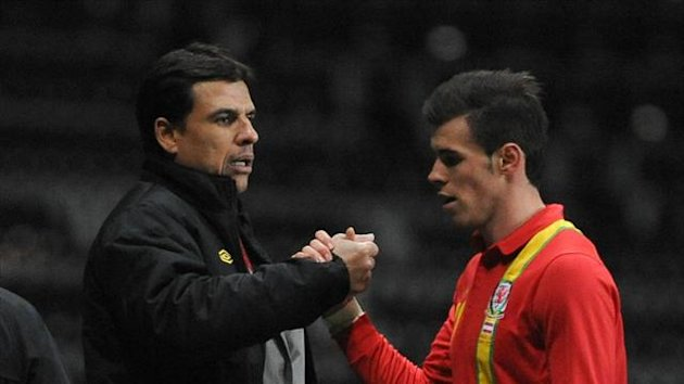 Chris Coleman, left, was delighted with a game-changing display from Gareth Bale, right