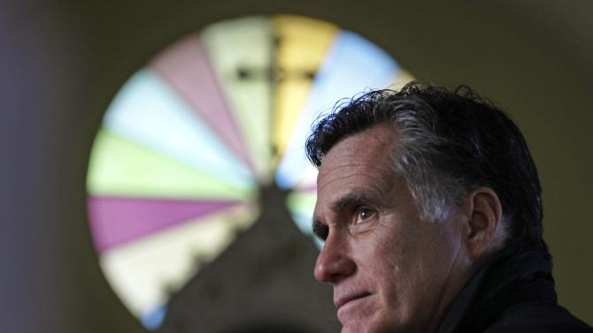FILE - In this Thursday Dec. 22, 2011 file photo, Republican presidential candidate, former Mass. Gov. Mitt Romney, visits St. Paul's Lutheran Church while campaigning in Berlin, N.H. How unthinkable it was, not so long ago, that a presidential election would pit a candidate fathered by an African against another condemned as un-Christian. And yet, here it is: Barack Obama vs. Mitt Romney, an African-American and a white Mormon, representatives of two groups and that have endured oppression to carve out a place in the United States. How much progress has America made against bigotry? (AP Photo/Charles Krupa)