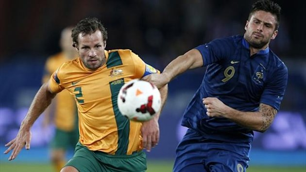 Australia's Lucas Neill (L) challenges France's Olivier Giroud during their friendly match at the Parc des Princes (Reuters)