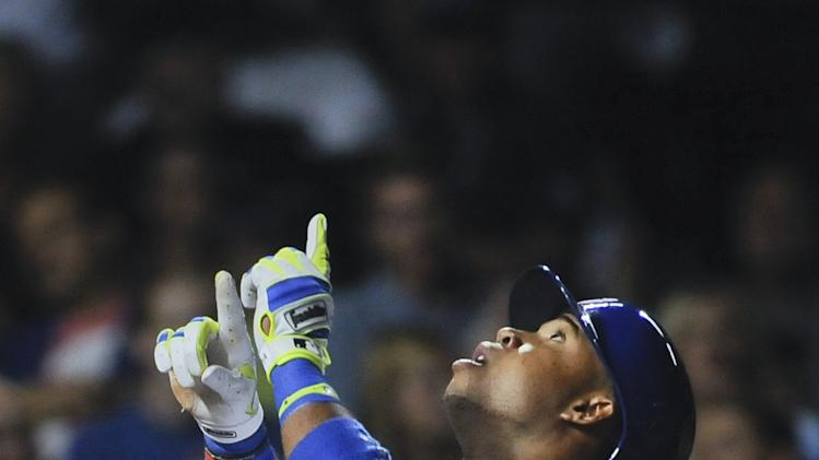 Chicago Cubs third baseman Luis Valbuena points to the sky after he hits a solo home run in the eight inning of a baseball game against the San Francisco Giants on Wednesday, August 20, 2014, in Chicago. (AP Photo/Matt Marton)