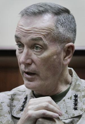 Top U.S. military commander in Afghanistan,, Joseph Dunford, gestures during an interview with the Associated Press at his headquarters in Kabul, Afghanistan, Monday, March 18, 2013. The top U.S. military commander in Afghanistan says he's working quickly to resolve issues that have infuriated Afghan President Hamid Karzai, including the delayed handover of a U.S.-run detention center and the withdrawal of U.S. special operations forces from a province outside Kabul. (AP Photo/Ahmad Jamshid)