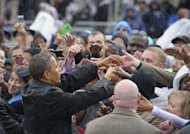US President Barack Obama greets supporters during a campaign rally on October 5, at Cleveland State University in Cleveland, Ohio. Obama has stashed $181 million into his re-election account to cheer supporters after his limp debate performance, but several polls show movement towards Republican Mitt Romney