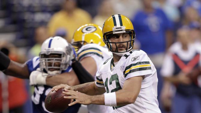 Green Bay Packers quarterback Aaron Rodgers throws against the Indianapolis Colts during the first quarter of an NFL preseason football game in Indianapolis, Friday, Aug. 26, 2011. (AP Photo/AJ Mast)