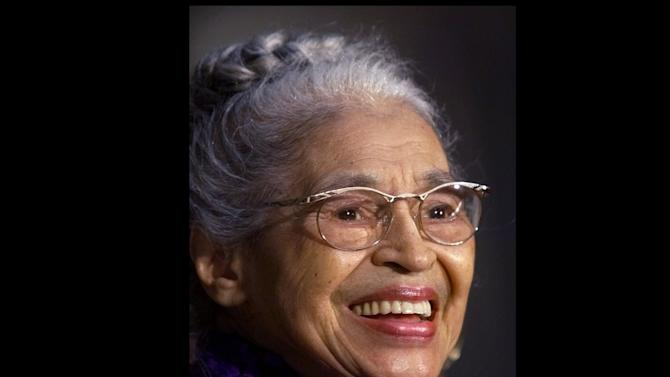 FILE -- In a June 15, 1999 file photo Rosa Parks smiles during a Capitol Hill ceremony where  Parks was honored with the Congressional Gold Medal in Washington.   Parks will become the first black woman to be honored with a full-length statue in the Capitol's Statuary Hall on Wednesday Feb. 27, 2013.   (AP Photo/Khue Bui, file)