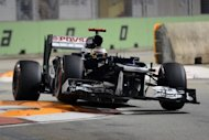 Williams driver Pastor Maldonado of Venuezela powers his car during the qualifying round at Formula One's Singapore Grand Prix in Singapore