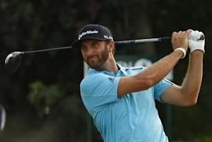 Dustin Johnson of the U.S. watches his tee shot during the second round of the British Open Championship at the Royal Liverpool Golf Club in Hoylake