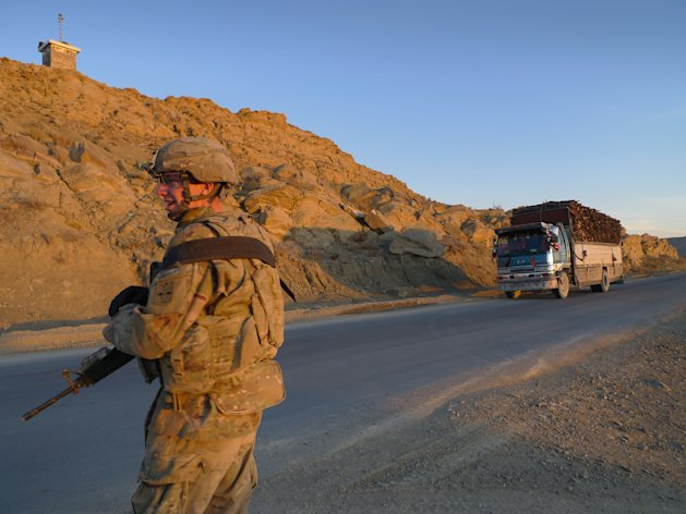 In this Wednesday, Nov. 30, 2011 photo, a U.S. soldier with Apache Company of Task Force 3-66 Armor, out of Grafenwoehr, Germany, watches passing trucks on security duty in the Sar Hawza district of Paktika province, south of Kabul, Afghanistan. U.S. forces achieved a rare concrete victory in the often undefined Afghan war when they seized this key mountain pass from the Taliban four months ago. But as American troops draw down in the war, it will fall on Afghan soldiers and police to hold this dirt road in eastern Afghanistan's Taba Kakar mountains. So far, the signs are not encouraging. (AP Photo/Heidi Vogt)