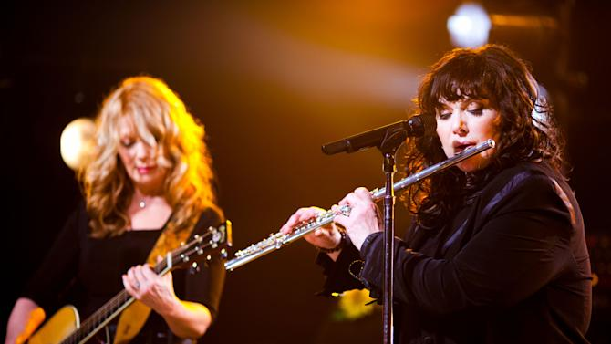 """FILE - In this Oct. 2, 2012 publicity file photo provided by iHeartRadio, Nancy Wilson, left, and Ann Wilson of Heart perform songs from their new album """"Fanatic"""" at the iHeartRadio Theater presented by P.C. Richard & Son in New York.  Heart is nominated for induction into the Rock and Roll Hall of Fame in 2013. (AP Photo/iHeartRadio, Peter Larson, File)"""
