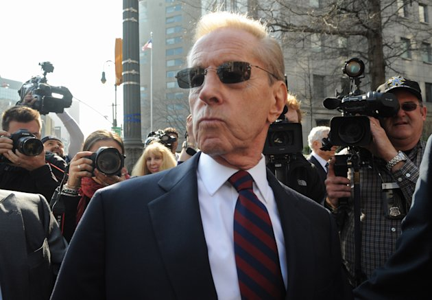 New York Mets&#39; owners Fred Wilpon leaves federal court in New York, Monday, March 19, 2012. The New York Mets owners and a trustee for Bernard Madoff&#39;s fraud victims have settled for $162 million. (AP Photo/ Louis Lanzano)