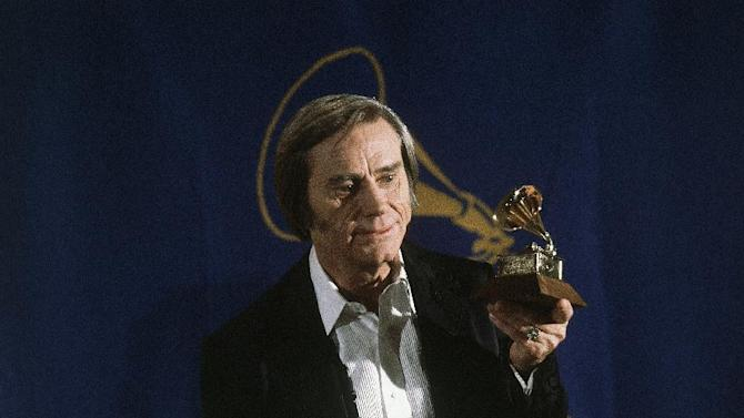 """FILE - In this Feb. 25, 1981 file photo, Country singer George Jones poses with the Grammy he won for best male country vocal performance of """"He Stopped Loving Her Today"""", at the awards at Radio City Music Hall in New York.  Jones, the peerless, hard-living country singer who recorded dozens of hits about good times and regrets and peaked with the heartbreaking classic """"He Stopped Loving Her Today,"""" has died. He was 81. Jones died Friday, April 26, 2013 at Vanderbilt University Medical Center in Nashville after being hospitalized with fever and irregular blood pressure, according to his publicist Kirt Webster. (AP Photo, file)"""