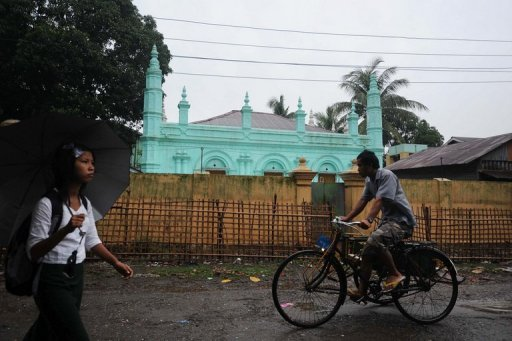 "<p>This file photo shows local residents passing a mosque in Sittwe, capital of Myanmar's western Rakhine state. Buddhist villagers fled their homes Saturday as renewed sectarian violence hit western Myanmar, officials said, blaming Muslim Rohingya people from a ""neighbouring country"" for the unrest.</p>"