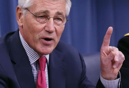 U.S. Secretary of Defense Chuck Hagel gestures as he speaks during a media briefing at the Pentagon in Washington