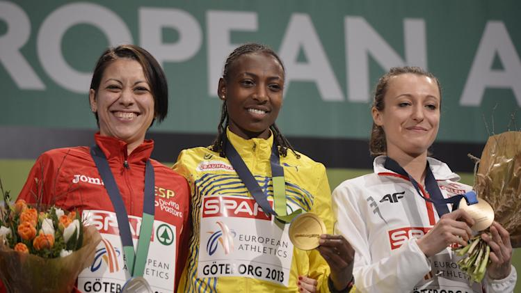 Sweden's gold medal winner Abeba Aregawi is flanked by Spain's silver medalist Isabel Macías, left, and Poland's bronze medal winner Katarzyna Broniatowska during the medal ceremony for the women's 1500m at  the Athletics Indoors European Championships in Gothenburg, Sweden, Saturday, March 2, 2013. (AP Photo/Martin Meissner)
