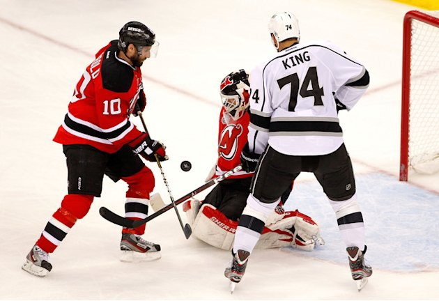 Martin Brodeur #30 Of The New Jersey Devils Tries To Make A Save As Peter Harrold #10 Of The New Jersey Devils And Getty Images