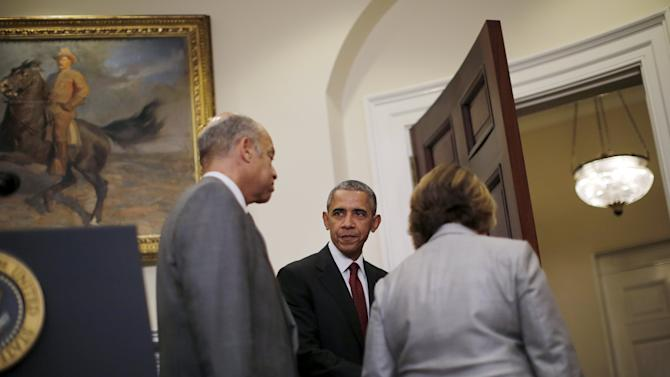 U.S. President Barack Obama looks at Homeland Security Secretary Jeh Johnsonafter delivering a statement at the White House in Washington