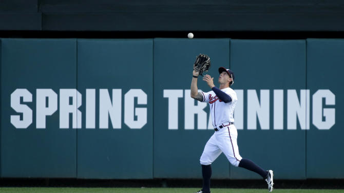 Atlanta Braves outfielder Jordan Schafer catches a fly ball hit by Detroit Tigers' Omar Infante during an exhibition baseball game, Friday, Feb. 22, 2013, in Kissimmee, Fla. (AP Photo/David J. Phillip)