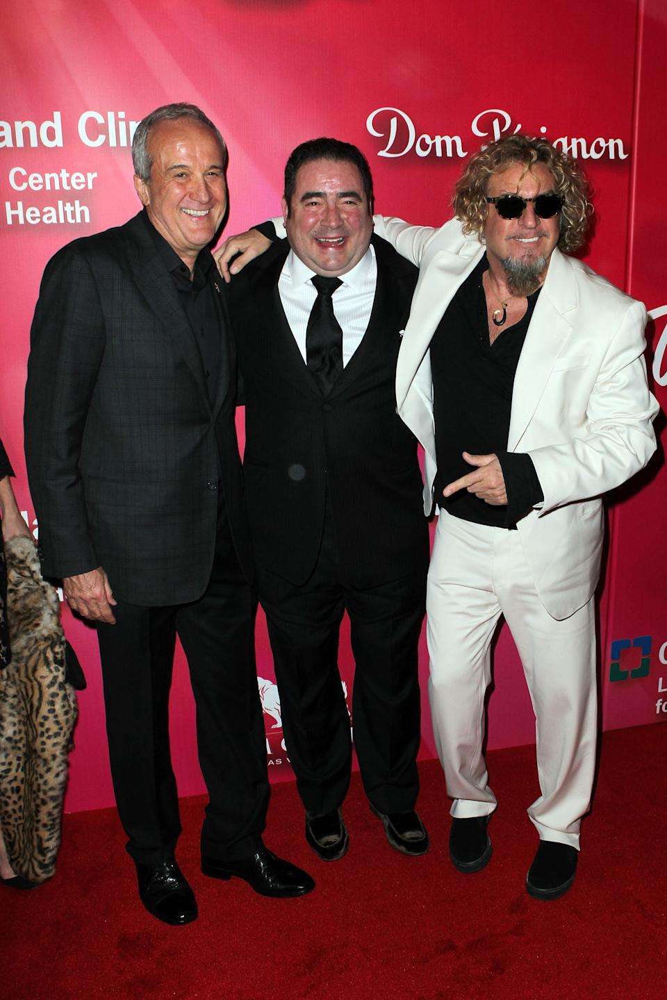 "Keep Memory Alive founder Larry Ruvo, Chef Emeril Lagasse and recording artist Sammy Hagar arrive at the Keep Memory Alive 16th Annual ""Power of Love Gala"" honoring Muhammad Ali with his 70th birthday celebration on Saturday, Feb. 18, 2012, in Las Vegas. (AP Photo/Jeff Bottari)"