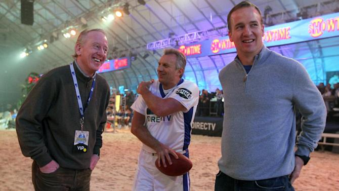 Former NFL quarterbacks Joe Montana, center, and Archie Manning, left,  talk with Indianapolis Colts quarterback Peyton Manning before the Celebrity Beach Bowl during festivities for the NFL football's Super Bowl XLVI, Saturday, Feb. 4, 2012, in Indianapolis. The New York Giants will face the New England Patriots in the Super Bowl on Feb. 5. (AP Photo/Jeff Roberson)