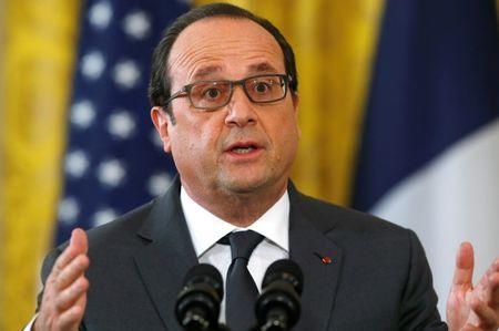 French President Hollande addresses joint news conference at the White House in Washington