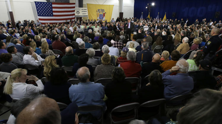 New Jersey Gov. Chris Christie, center right, addresses an overflow crowd at Saint Mary's of The Pines Church Parish Wednesday, Jan. 16, 2013, in Manahawkin, N.J., as he returned to the Jersey Shore for his 100th town hall. The 2-square-mile community of 2,300 people in Ocean County is the gateway to Long Beach Island, an area hit hard by Superstorm Sandy. (AP Photo/Mel Evans)