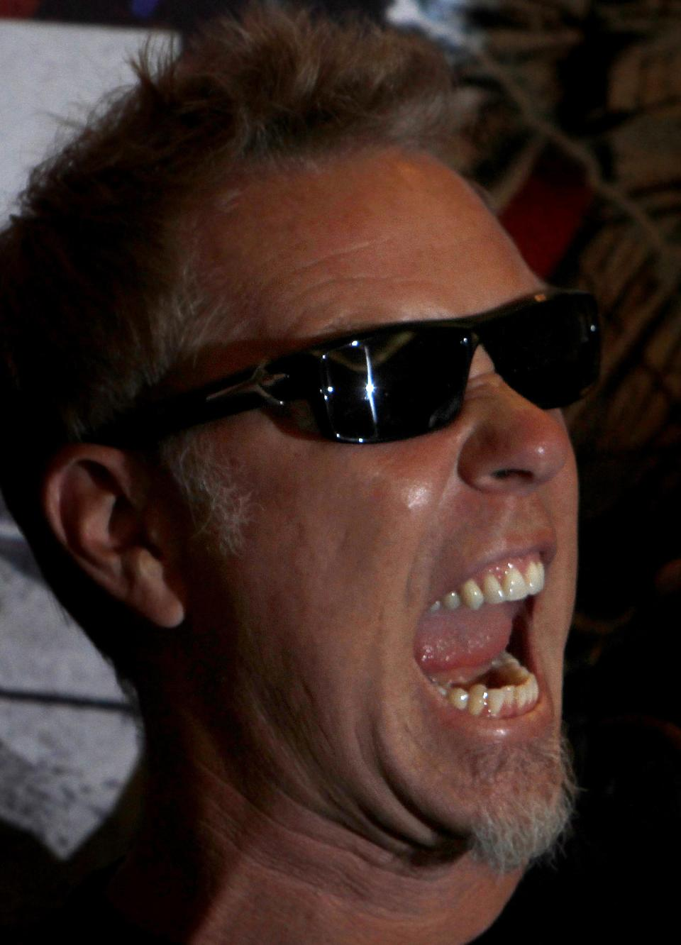 Metallica's lead vocalist James Hetfield poses at a photocall before his band's first of eight concert performances in Mexico City, Saturday, July 28, 2012.  The heavy metal band added two more tour dates to their Mexico City run after a record six sold out August shows. (AP Photo/Marco Ugarte)