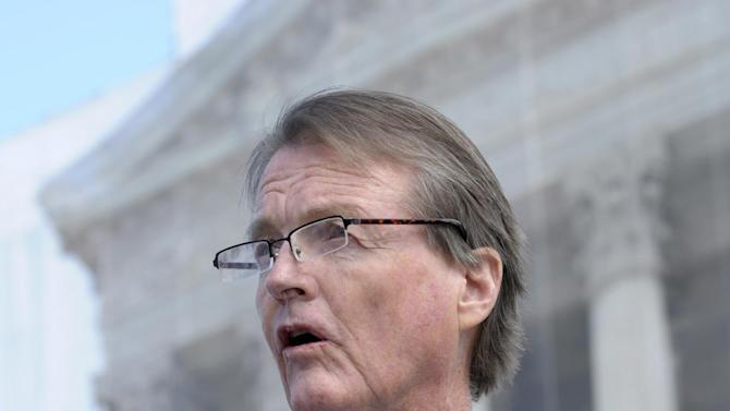 The University of Texas at Austin President Bill Powers speaks to reporters outside the Supreme Court in Washington, Wednesday, Oct. 10, 2012. The Supreme Court is taking up a challenge to a University of Texas program that considers race in some college admissions. The case could produce new limits on affirmative action at universities, or roll it back entirely. (AP Photo/Susan Walsh)