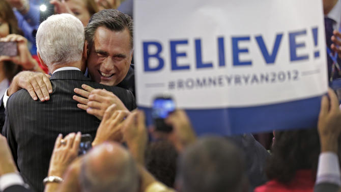 Republican presidential nominee Mitt Romney hugs a supporter as he walks to the stage during the Republican National Convention in Tampa, Fla., on Thursday, Aug. 30, 2012. (AP Photo/J. Scott Applewhite)
