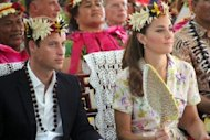 Prince William (L) and his wife Catherine attend a farewell ceremony in Tuvalu on September 19. A Danish magazine on Thursday became the latest to run pictures of Prince William's wife Catherine topless, despite moves by furious British royals to stop the spread of the photos