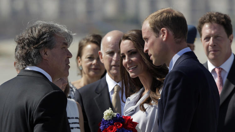 Prince William and Kate, the Duke and Duchess of Cambridge, talk to Canadian Consul General David Fransen, left, as they arrive at Los Angeles International Airport in Los Angeles, Friday, July 8, 2011. California Gov. Jerry Brown, background center, looks on. (AP Photo/Jae C. Hong)
