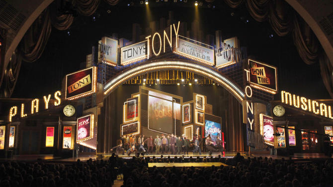 """FILE - In this June 7, 2009 file photo, actors perform a segment from the show Guys and Dolls at the 63rd annual Tony Awards in New York. The Broadway League and the American Theatre Wing, joint producers of the Tony Awards show, said that the glittery event will be broadcast live from Radio City Music Hall this year. Producers of the show were forced to find a new home for the 2011 event after Cirque du Soleil moved into the 6,000-seat Rockefeller Center arena with its $50 million acrobatic rock opera """"Zarkana."""" The Tonys had been hosted at Radio City since 1997. For the past two years, the Tonys were handed out at the Beacon Theater on Manhattan's Upper West Side. The venue was much smaller, having only about 2,870 seats, leading to ticket-rationing.  (AP Photo/Seth Wenig, File)"""