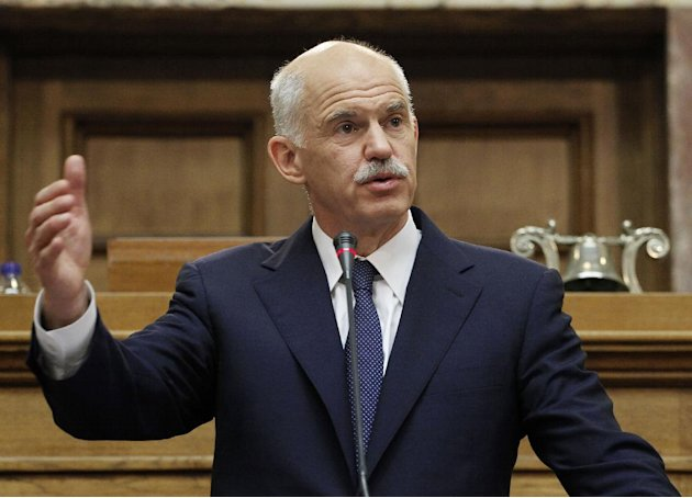 FILE - In this Thursday, Nov. 3, 2011 file photo Greek Prime Minister George Papandreou addresses Socialist lawmakers members of parliament in Athens, in Athens. French President Nicolas Sarkozy is wi