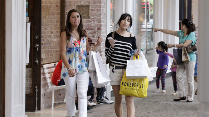 In this Wednesday, May 30, 2012, photo, shoppers walk through the South Shore Mall in Braintree, Mass. Some major retailers  on Thursday, May 31, 2012, posted sales increases that beat Wall Street estimates as shoppers were lured in by Mother's Day promotions and colorful new styles of clothing. The gains follow a dismal showing from the month before.  (AP Photo/Stephan Savoia)