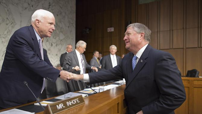 Sen. John McCain, R-Ariz., left, welcomes Secretary of the Air Force Michael B. Donley, right, as the Senate Armed Services Committee hears from top officials of the Air Force during a hearing on Capitol Hill in Washington, Tuesday, May 7, 2013. Besides funding for next year's Pentagon budget, the Air Force is dealing with controversy over sexual assaults and how the military justice system handles it. (AP Photo/J. Scott Applewhite)