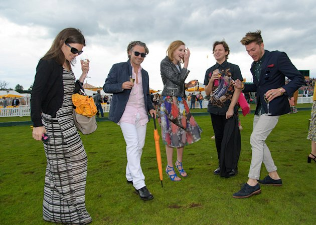MIDHURST, UNITED KINGDOM - JULY 15: Laura Carmichael, Christopher Kane and Henry Holland treading in at the Veuve Clicquot Gold Cup Final at Cowdray Park Polo Club on July 15, 2012 in Midhurst, England. (Photo by Nick Harvey/WireImage)