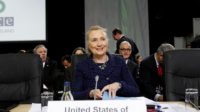 US Secretary of State Hillary Rodham Clinton smiles during the opening session of the Organisation for Security and Co-operation in Europe meeting in  Dublin Thursday Dec. 6, 2012. (AP Photo/Julien Behal/PA) UNITED KINGDOM OUT