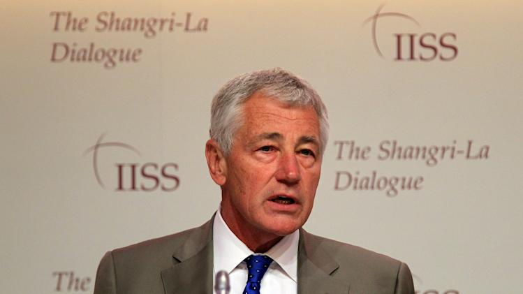 "U.S. Defense Secretary Chuck Hagel waits to deliver his keynote address on ""The US Approach to Regional Security"" at the International Institute for Strategic Studies Shangri-la Dialogue, or IISS Asia Security Summit in Singapore, Saturday, June 1, 2013. (AP Photo/Wong Maye-E)"